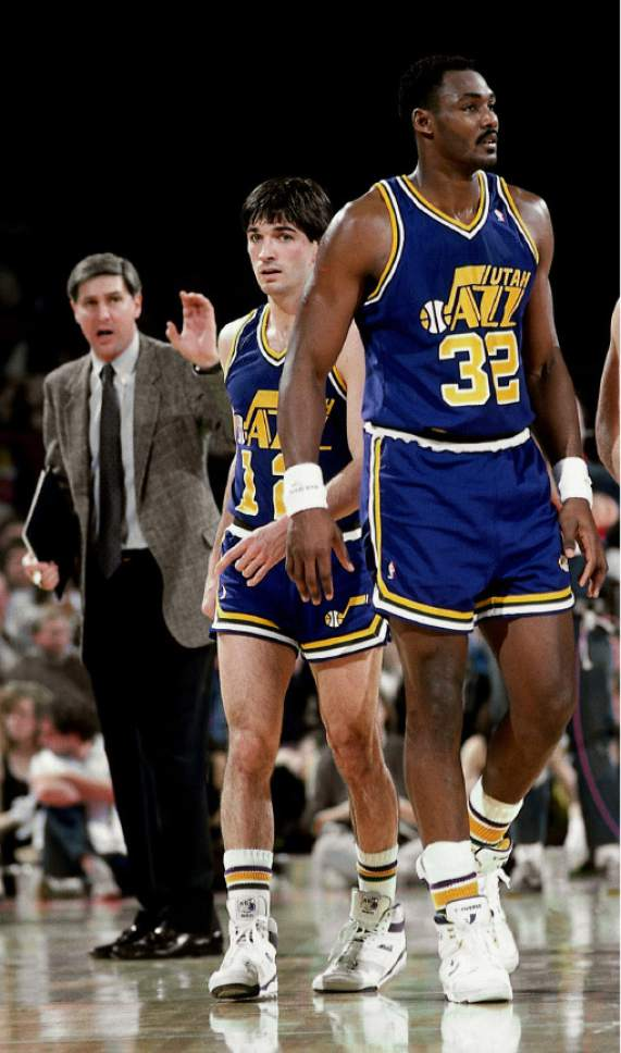 ATLANTA -1986:  Karl Malone #32 and John Stockton #12 of the Utah Jazz head onto court after meeting with head coach Jerry Sloan against the Atlanta Hawks at the Omni circa 1986 in Atlanta, Georgia.  NOTE TO USER: User expressly acknowledges and agrees that, by downloading and/or using this Photograph, user is consenting to the terms and conditions of the Getty Images License Agreement.  Mandatory Copyright Notice: Copyright 1986 NBAE (Photo by Scott Cunningham/NBAE via Getty Images)