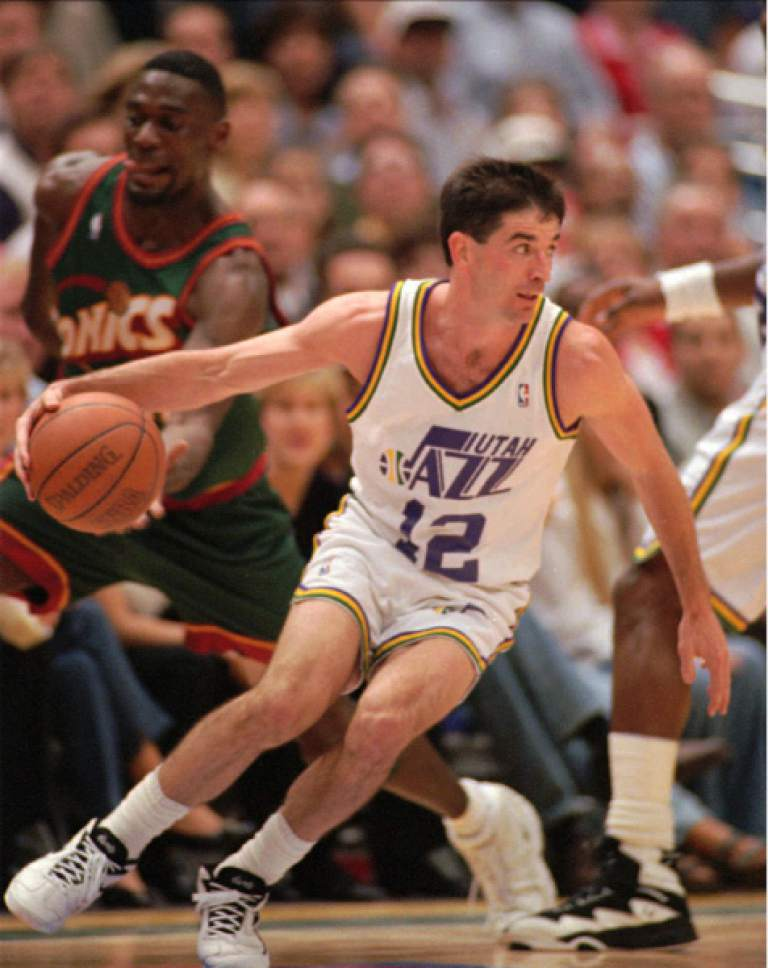 Seattle SuperSonics forward Shawn Kemp reaches for the ball as Utah Jazz guard John Stockton (12) takes off for the basket in the third period Thursday, May 30, 1996, in Salt Lake City.  The Jazz beat the Sonics 118-83. (AP Photo/Douglas C. Pizac)