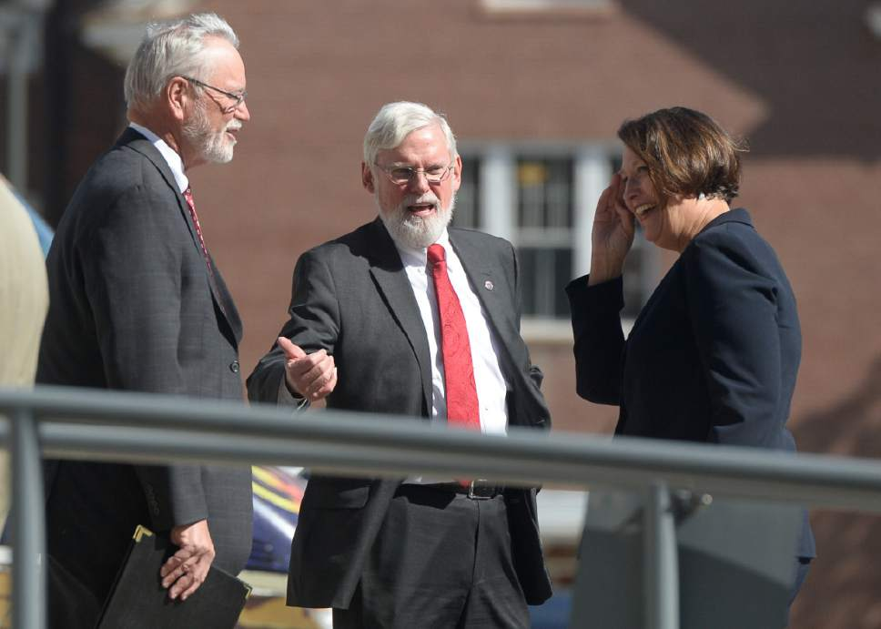 "Francisco Kjolseth  |  The Salt Lake Tribune University of Utah President David Pershing, center, speaks with A. Lorris Betz, the interim U. Health Care CEO and Ruth Watkins, Sr. VP of Academic Affairs following a meeting at the Spencer F. and Cleone P. Eccles Health and Sciences Building on Monday, May 1, 2017. President Pershing announced he will be stepping down from his post, and that the search for his replacement will run in ""parallel"" with the hiring process for a new Health Sciences vice president to replace Vivian Lee, who resigned Friday amid controversy."