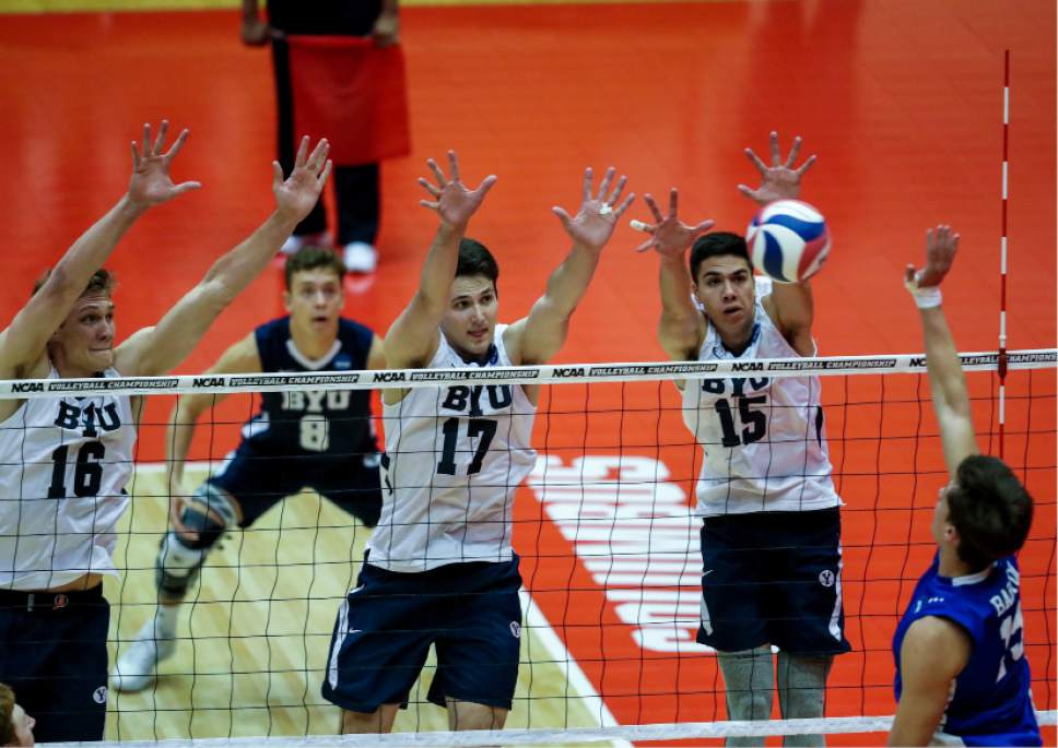 Courtesy photo  |  BYU Sports Information BYUís Tim Dobbert (16), Joseph Grosh (17) and Brenden Sander go up for a block against Barton College during their NCAA tournament play-in game Tuesday in Columbus Ohio. BYU swept Barton to advance to Thursdayís semifinal against Long Beach State.