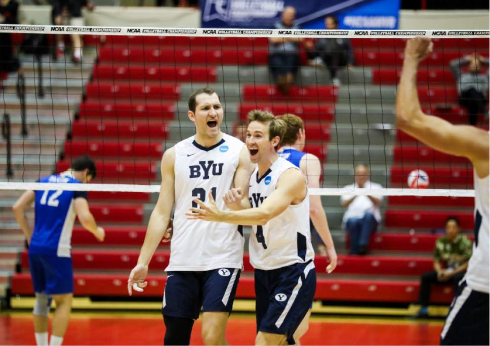 |  BYU Photo  BYU's Christian Rupert (21), and Leo Durkin (4) celebrate a point against Barton College during the NCAA Championships May 2, 2017 in Columbus Ohio.