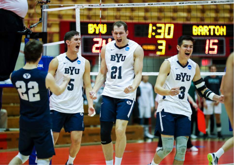 |  BYU Photo  BYU's Kiril Meretev (5), Christian Rupert (21), and Wil Stanley (3) celebrate a point against Barton College during the NCAA Championships May 2, 2017 in Columbus Ohio.