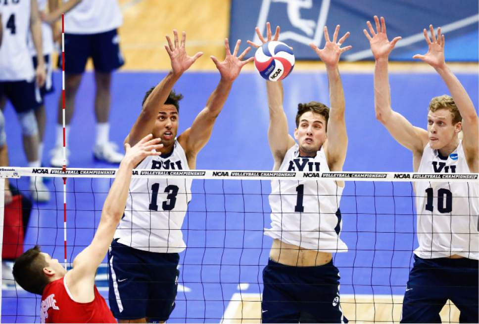 Patch, Jarman, Langlois_W2_4753  BYU's Ben Patch, Price Jarman and Jake Langlois block a ball. The BYU men's volleyball was defeated by Ohio State 0-3 in the Championship Match of the NCAA Men's Volleyball Championships. The Championships were hosted at Rec Hall, on the Penn State campus in University Park, Pennsylvania.  April 7, 2016  Photo by Jaren Wilkey/BYU  © BYU PHOTO 2016 All Rights Reserved photo@byu.edu  (801)422-7322