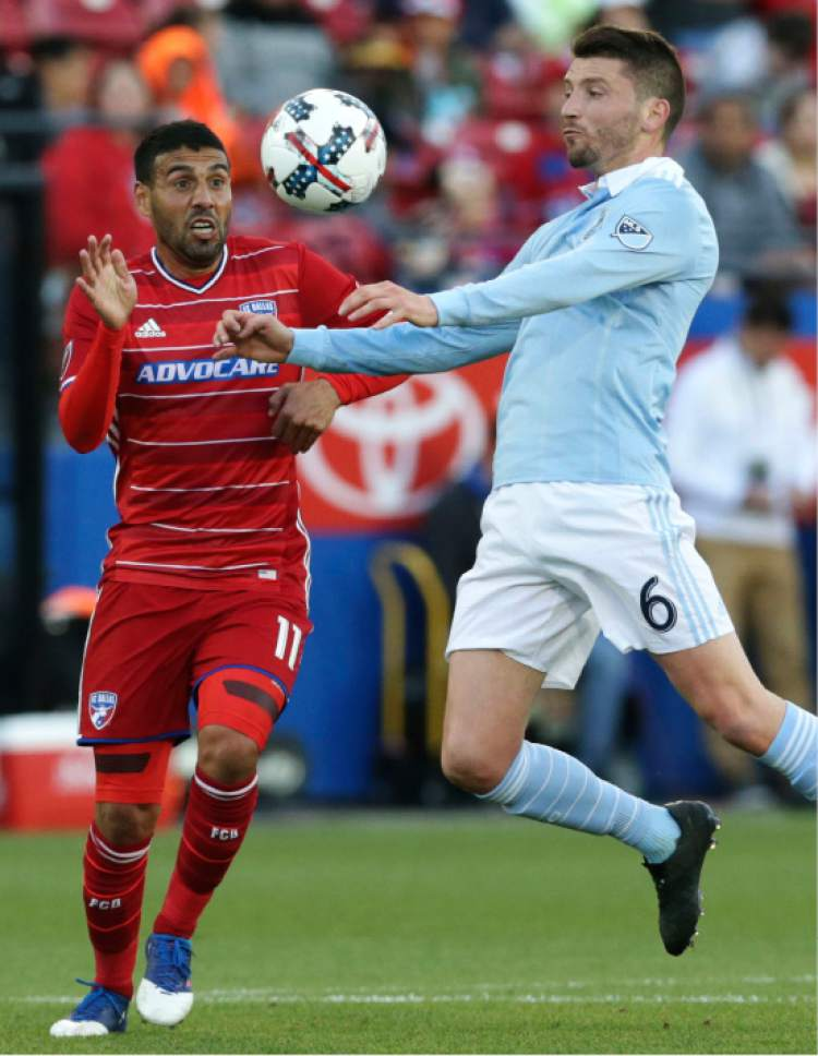 Sporting Kansas City midfielder Ilie Sanchez (6) and FC Dallas midfielder Javier Morales (11) vie for control of the ball during the first half of an MLS soccer match in Frisco, Texas, Saturday, April 22, 2017. (AP Photo/LM Otero)