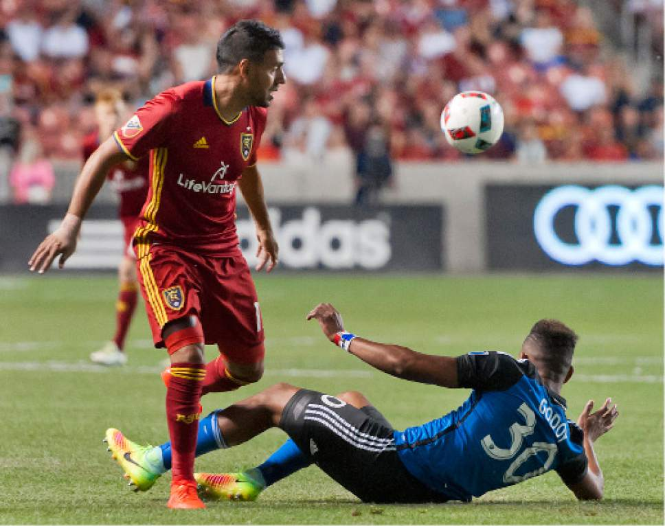 Michael Mangum  |  Special to the Tribune  Real Salt Lake midfielder Javier Morales (11) and San Jose midfielder Anibal Godoy (30) jostle for possession during their MLS match at Rio Tinto Stadium in Sandy, Utah on Friday, July 22nd, 2016.