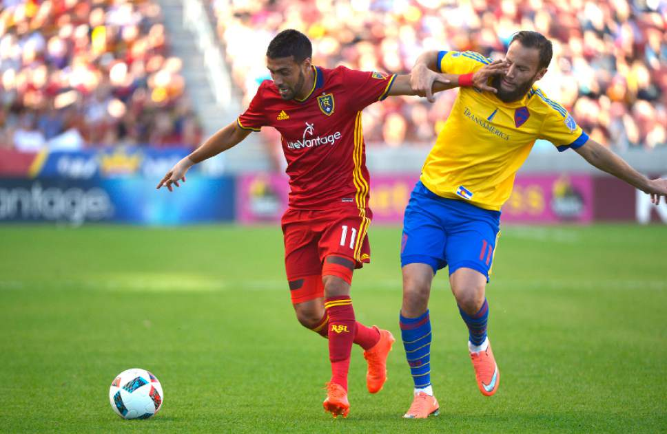 Leah Hogsten  |  The Salt Lake Tribune Real Salt Lake midfielder Javier Morales (11) battles Colorado Rapids midfielder Shkelzen Gashi (11). Real Salt Lake is tied 1-1with the Colorado Rapids during their Rocky Mountain Championship Cup game at Rio Tinto Stadium Friday, August 26, 2016.