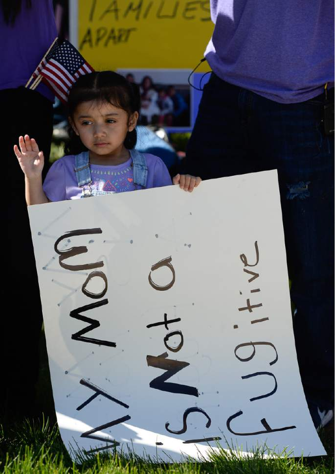 Francisco Kjolseth | The Salt Lake Tribune Ariana Juarez, 2, who's mother was detained by ICE agents and taken to an undisclosed location last week, stands in silence during a rally by Mormon Women for Ethical Government and other concerned citizens who gathered at the Department of Homeland Security field office in West Valley City on Wed. May 3, 2017, in a show of solidarity for the young mother, Silvia Avelar-Flores, who was arrested.