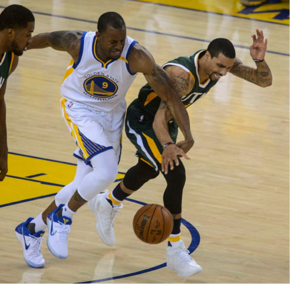 Steve Griffin  |  The Salt Lake Tribune   Golden State Warriors forward Andre Iguodala (9) battles Utah Jazz guard George Hill (3) as the run up the court during NBA playoff game between the Utah Jazz and the Golden State Warriors at Oracle Arena in Oakland Tuesday May 2, 2017.