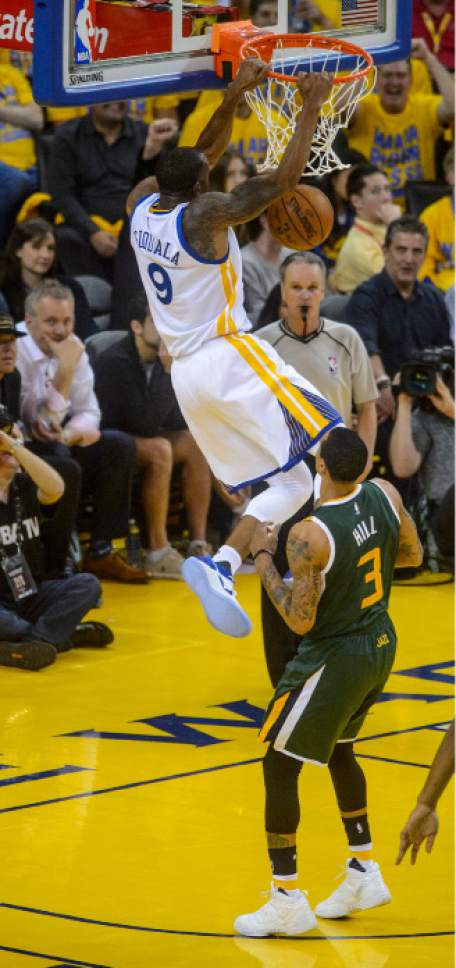 Steve Griffin  |  The Salt Lake Tribune   Golden State Warriors forward Andre Iguodala (9) slams down the ball over Utah Jazz guard George Hill (3) during NBA playoff game between the Utah Jazz and the Golden State Warriors at Oracle Arena in Oakland Tuesday May 2, 2017.