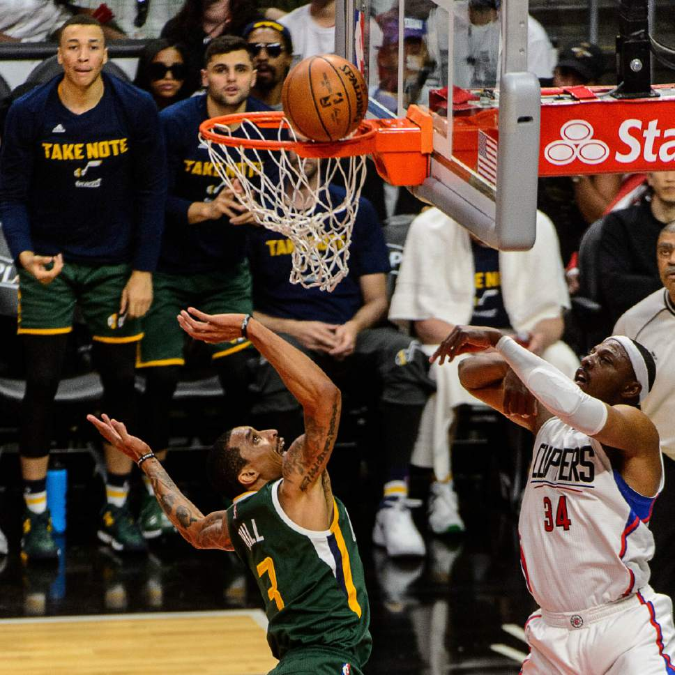Trent Nelson  |  The Salt Lake Tribune Utah Jazz guard George Hill (3) shoots, with LA Clippers forward Paul Pierce (34) defending, as the Utah Jazz face the Los Angeles Clippers in Game 7 at STAPLES Center in Los Angeles, California, Sunday April 30, 2017.