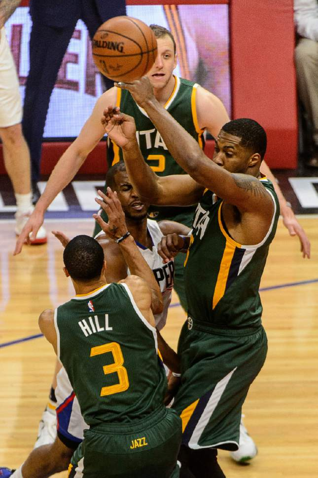 Trent Nelson  |  The Salt Lake Tribune LA Clippers guard Chris Paul (3) passes through the arms of Utah Jazz guard George Hill (3) and Utah Jazz forward Derrick Favors (15) as the Utah Jazz face the Los Angeles Clippers in Game 7 at STAPLES Center in Los Angeles, California, Sunday April 30, 2017.