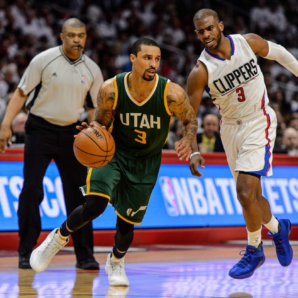 Trent Nelson  |  The Salt Lake Tribune Utah Jazz guard George Hill (3) drives on LA Clippers guard Chris Paul (3) as the Utah Jazz face the Los Angeles Clippers in Game 7 at STAPLES Center in Los Angeles, California, Sunday April 30, 2017.