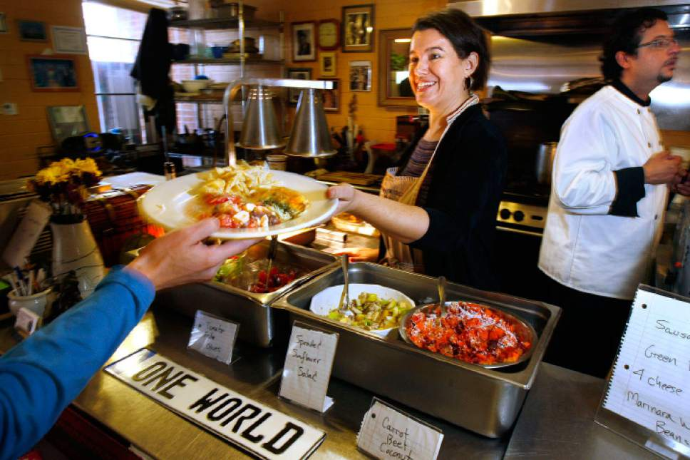 Scott Sommerdorf  |  The Salt Lake Tribune In this 2008 file photo, Denise Cerreta helps serve a customer's lunch at The One World Cafe in Salt Lake City.