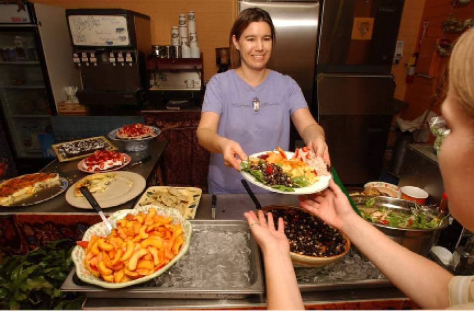 Rick Egan  |  The Salt Lake Tribune  Denise Cerreta  dishes up some of her organic food at the One World Cafe on Sept. 4, 2003.