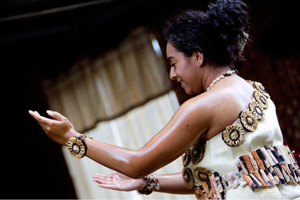    Tribune File Photo  Chelsey Uesi, 20, performs a Tauolunga, a traditional Tongan dance, for Halaevalu Mata'aho, the Queen Mother of Tonga, during an evening prayer and celebration at a home in West Valley City, Utah, on Wednesday, August 3, 2011.