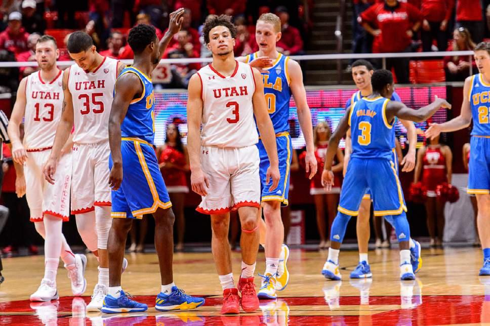 Trent Nelson  |  The Salt Lake Tribune Utah Utes forward David Collette (13), forward Kyle Kuzma (35), and guard Devon Daniels (3) react to the loss as the University of Utah hosts UCLA, NCAA mens basketball at the Huntsman Center in Salt Lake City, Saturday January 14, 2017.