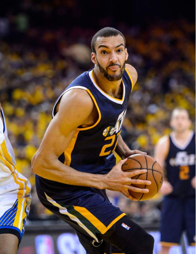 Steve Griffin  |  The Salt Lake Tribune   Utah Jazz center Rudy Gobert (27) spins tot he basket during game 2 of the NBA playoff game between the Utah Jazz and the Golden State Warriors at Oracle Arena in Oakland Thursday May 4, 2017.