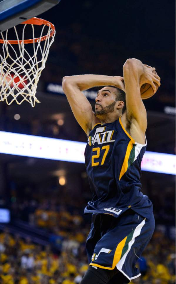 Steve Griffin  |  The Salt Lake Tribune   Utah Jazz center Rudy Gobert (27) glides to the basket as he gets ready dunk the ball during game 2 of the NBA playoff game between the Utah Jazz and the Golden State Warriors at Oracle Arena in Oakland Thursday May 4, 2017.
