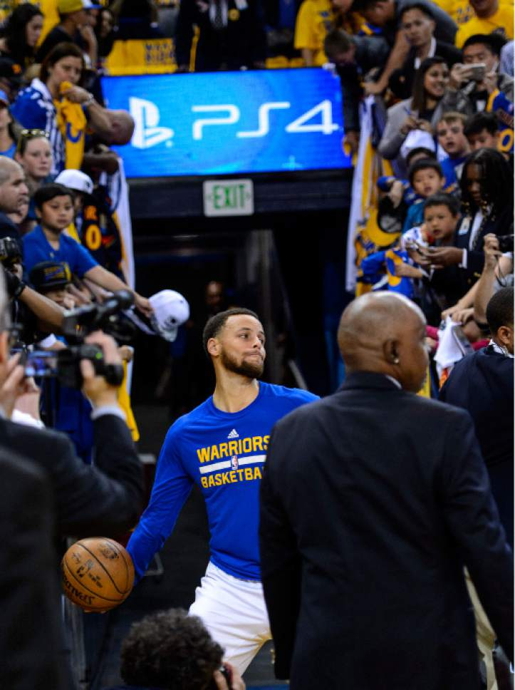 Steve Griffin  |  The Salt Lake Tribune   Golden State Warriors guard Stephen Curry (30) fires a full court shot from the team's tunnel prior to game 2 of the NBA playoff game between the Utah Jazz and the Golden State Warriors at Oracle Arena in Oakland Thursday May 4, 2017. Curry has a pre-game routine that includes the long shot.