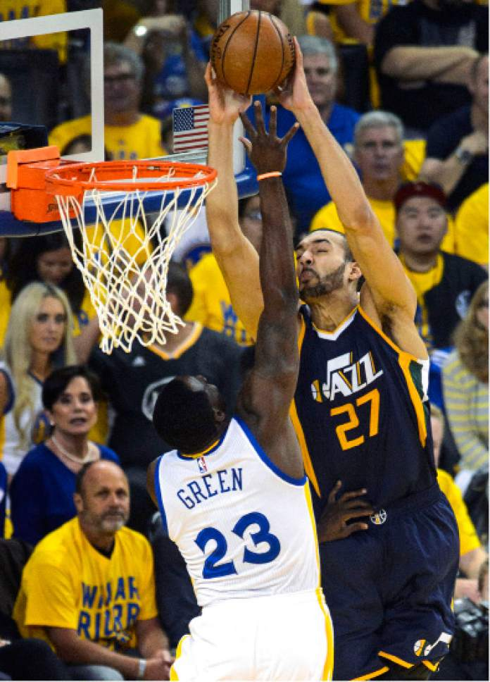 Steve Griffin  |  The Salt Lake Tribune   Golden State Warriors forward Draymond Green (23) blocks a dunk attempt by Utah Jazz center Rudy Gobert (27) during game 2 of the NBA playoff game between the Utah Jazz and the Golden State Warriors at Oracle Arena in Oakland Thursday May 4, 2017.