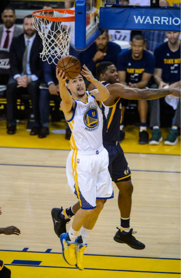 Steve Griffin  |  The Salt Lake Tribune   Golden State Warriors guard Klay Thompson (11) gets to the basket during game 2 of the NBA playoff game between the Utah Jazz and the Golden State Warriors at Oracle Arena in Oakland Thursday May 4, 2017.