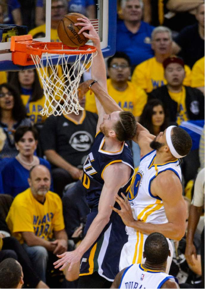 Steve Griffin  |  The Salt Lake Tribune   Utah Jazz forward Gordon Hayward (20) gets fouled by Golden State Warriors center JaVale McGee (1) as he tries to slam the ball during game 2 of the NBA playoff game between the Utah Jazz and the Golden State Warriors at Oracle Arena in Oakland Thursday May 4, 2017.