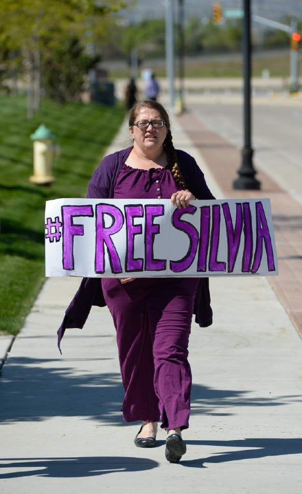 Francisco Kjolseth | The Salt Lake Tribune Dovie Peterson joins Mormon Women for Ethical Government and other concerned citizens as they gather at the Department of Homeland Security field office in West Valley City on Wednesday, May 3, 2017, in a show of solidarity for a young mother named Silvia, who was arrested by ICE agents last week.