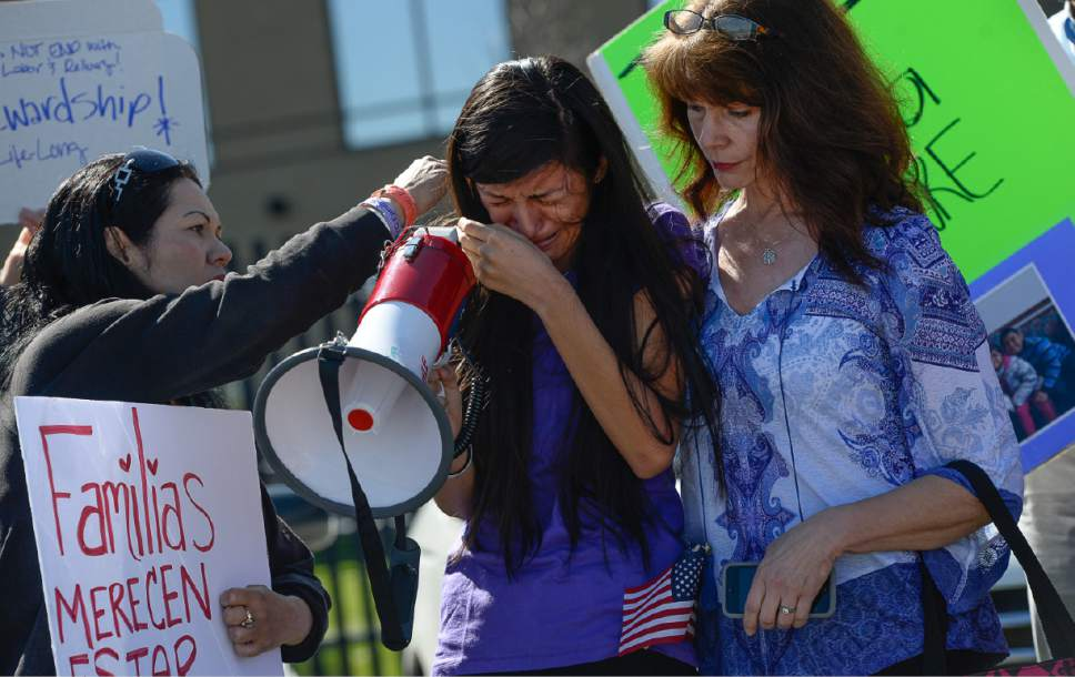 Francisco Kjolseth | The Salt Lake Tribune Abigail Tapia, 15, is comforted as she speaks about missing her aunt, Silvia Avelar-Flores, who was detained by ICE agents in a Michaels parking lot last week in front of her 8-year-old daughter. Mormon Women for Ethical Government and other concerned citizens gathered at the Department of Homeland Security field office in West Valley City on Wed. May 3, 2017, in a show of solidarity for a young mother and her family.