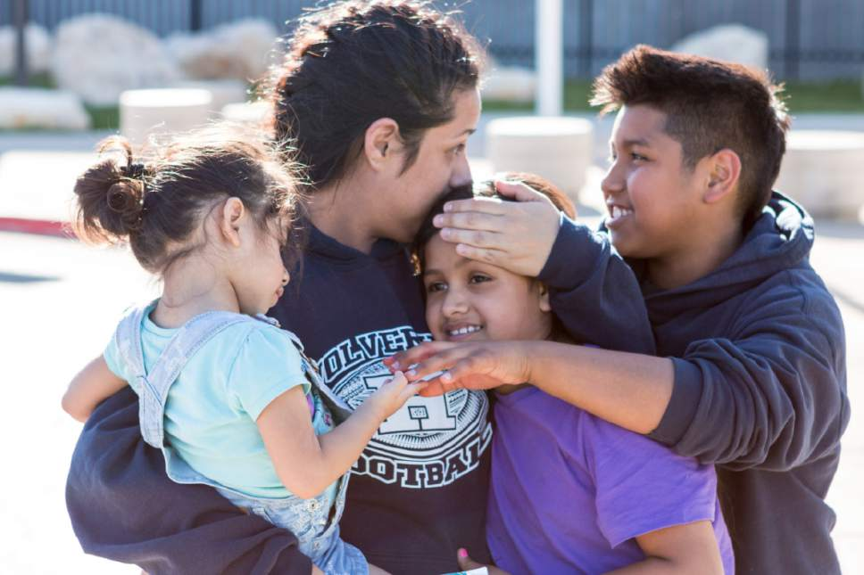 Sydney Oliver  |  Special to The Tribune  Silvia Avelar-Flores is comforted by her 3 children, Adrian, 10, Jazira, 8, and Ariana, 2, after being released from the Cache County Jail. Avelar-Flores has been detained since Friday, April 28, 2017 after being arrested by Immigration and Customs Enforcement agents In West Valley, Utah.