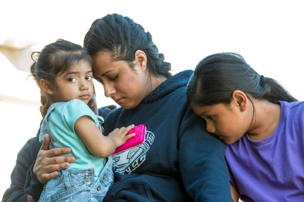 Sydney Oliver  |  Special to The Tribune  Silvia Avelar-Flores is comforted by her daughters Jazira, 8, and Ariana, 2, after anxiously waiting her release from Cache County Jail. Avelar-Flores has been detained since Friday, April 28, 2017 after being arrested by Immigration and Customs Enforcement agents In West Valley, Utah.