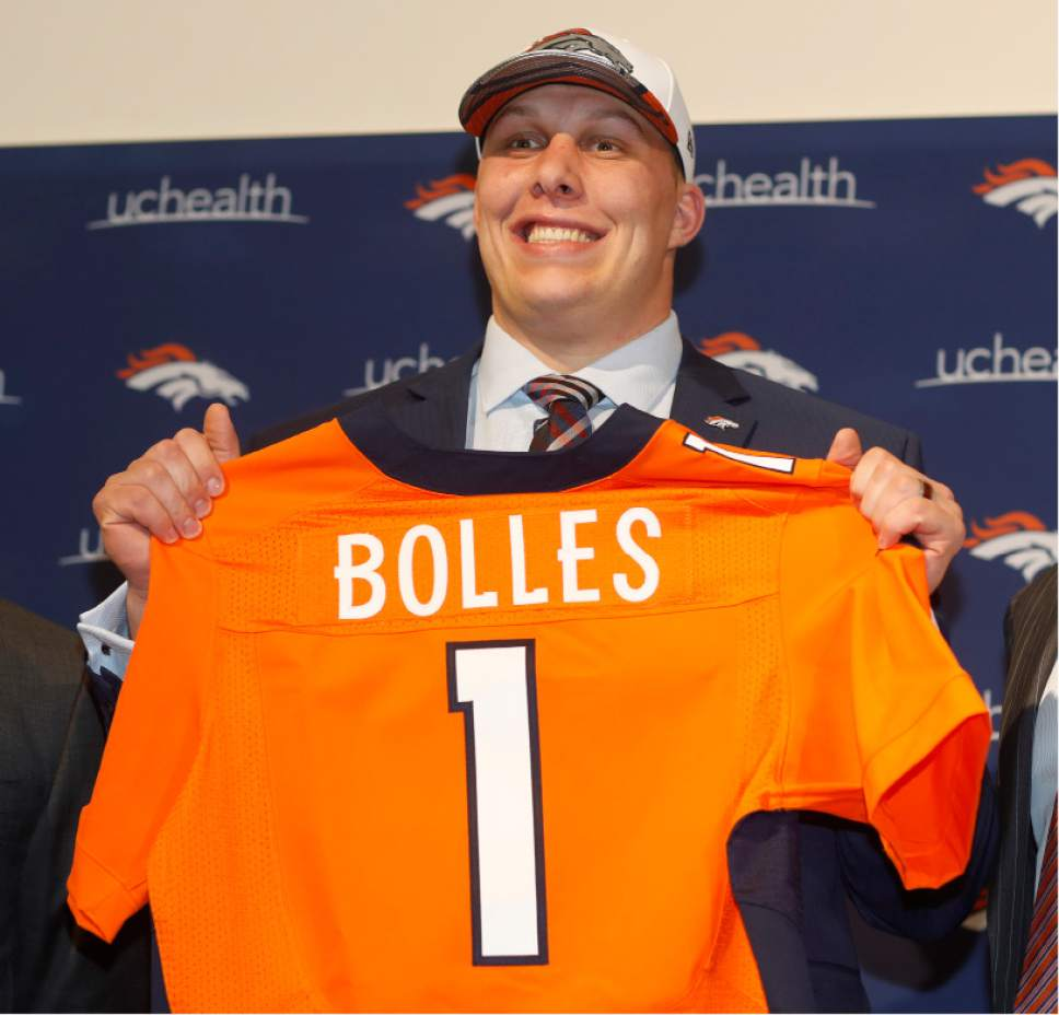 Denver Broncos first-round selection int he NFL draft, offensive tackle Garett Bolles, holds up his new jersey during a news conference at the team's headquarters Friday, April 28, 2017, in Englewood, Colo. (AP Photo/David Zalubowski)