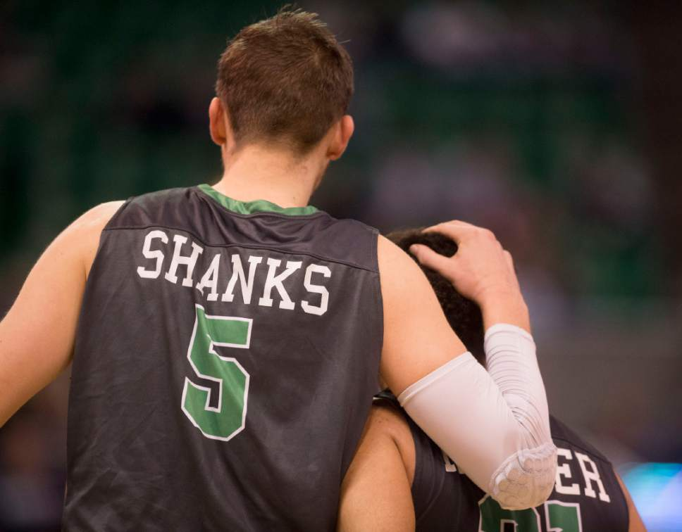 Trent Nelson  |  The Salt Lake Tribune  North Dakota Fighting Sioux center Carson Shanks (5) and North Dakota Fighting Sioux guard Quinton Hooker (21) leave the court after losing to Arizona during the first round of the NCAA Tournament in Salt Lake City on Thursday, March 16, 2017.