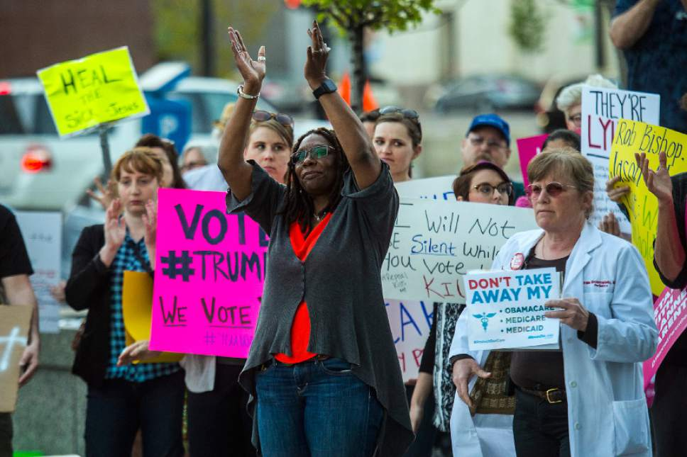 Chris Detrick  |  The Salt Lake Tribune Darlene McDonald, who is running against Rep. Mia Love, R-Utah, claps during the Utah Hands Off Our Healthcare Rally at the Wallace F. Bennett Federal Building in Salt Lake City Thursday, May 4, 2017.