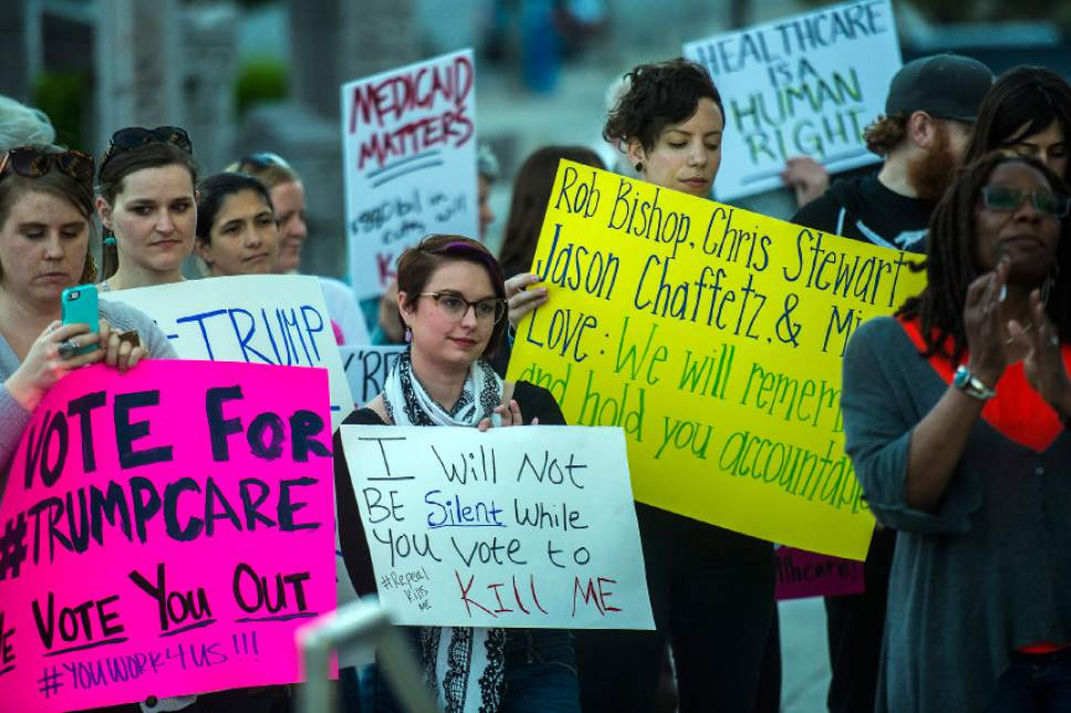 Chris Detrick  |  The Salt Lake Tribune Participants hold signs and listen during the Utah Hands Off Our Healthcare Rally at the Wallace F. Bennett Federal Building in Salt Lake City Thursday, May 4, 2017.