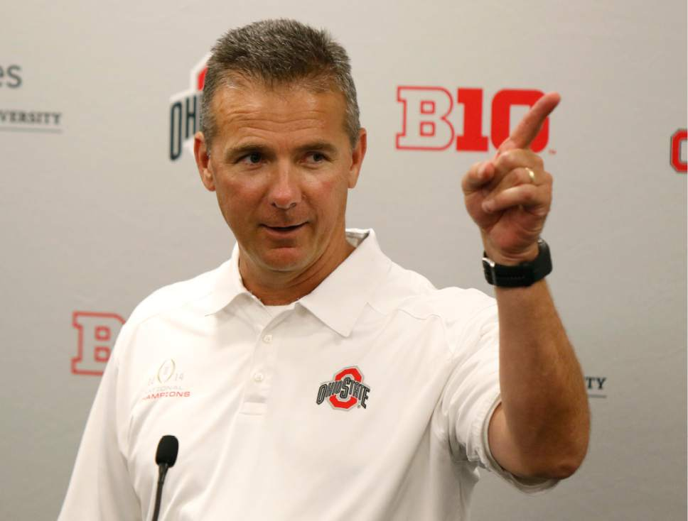 FILE - In this Aug. 16, 2015, file photo, Ohio State coach Urban Meyer speaks to reporters during the university's NCAA college football media day in Columbus, Ohio. Since taking over at Ohio State, Meyer has insisted he is a changed man, just as intense but better able to enjoy success. This season, will put Meyer's new outlook to the test. (AP Photo/Paul Vernon, File)