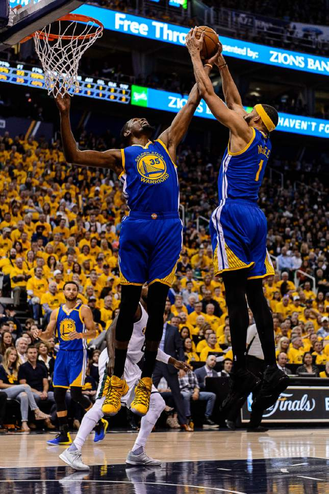 Trent Nelson  |  The Salt Lake Tribune Golden State Warriors forward Kevin Durant (35) and Golden State Warriors center JaVale McGee (1) pull down a rebound as the Utah Jazz host the Golden State Warriors in Game 3 of the second round, NBA playoff basketball in Salt Lake City, Saturday May 6, 2017.