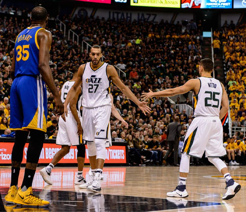 Trent Nelson  |  The Salt Lake Tribune Utah Jazz center Rudy Gobert (27) and Utah Jazz guard Raul Neto (25) high-five as the Utah Jazz host the Golden State Warriors in Game 3 of the second round, NBA playoff basketball in Salt Lake City, Saturday May 6, 2017.