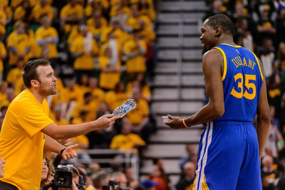 Trent Nelson  |  The Salt Lake Tribune A Jazz fan and Golden State Warriors forward Kevin Durant (35) as the Utah Jazz host the Golden State Warriors in Game 3 of the second round, NBA playoff basketball in Salt Lake City, Saturday May 6, 2017.