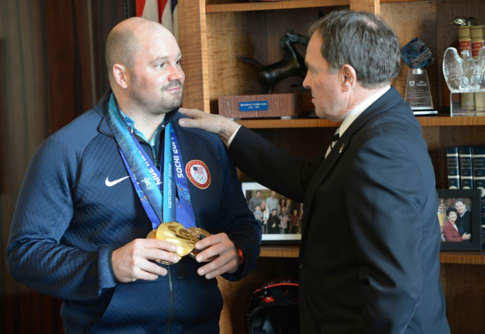 Al Hartmann  |  The Salt Lake Tribune  Park City olympian Steve Holcomb stops in at Governor Gary Herbert's office Monday March 3 to show him his two bronze medals he won at the Soch olympics.   He also had his gold medal from Vancouver 2010 Olympics.  He was pilot for the two-man and four-man bobsled teams.