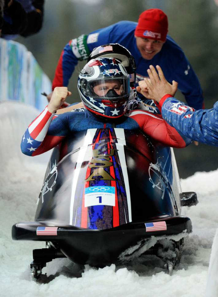 The United States' USA-1, with Steven Holcomb, front, Justin Olsen, Steve Mesler, and Curtis Tomasevicz, celebrate their gold medal finish during the men's four-man bobsled final competition at the Vancouver 2010 Olympics in Whistler, British Columbia, Saturday, Feb. 27, 2010. (AP Photo/Jens Meyer)