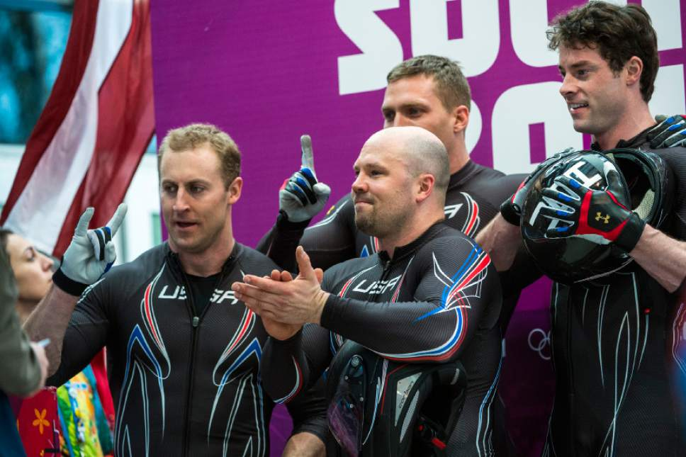 KRASNAYA POLYANA, RUSSIA  - JANUARY 23: USA's Steven Holcomb, Chris Fogt, Curtis Tomasevicz, and Steve Langton, celebrate after the four-man bobsled at Sanki Sliding Center during the 2014 Sochi Olympics Sunday February 23, 2014. They won the bronze medal with a cumulative time of 3:40.99.  (Photo by Chris Detrick/The Salt Lake Tribune)