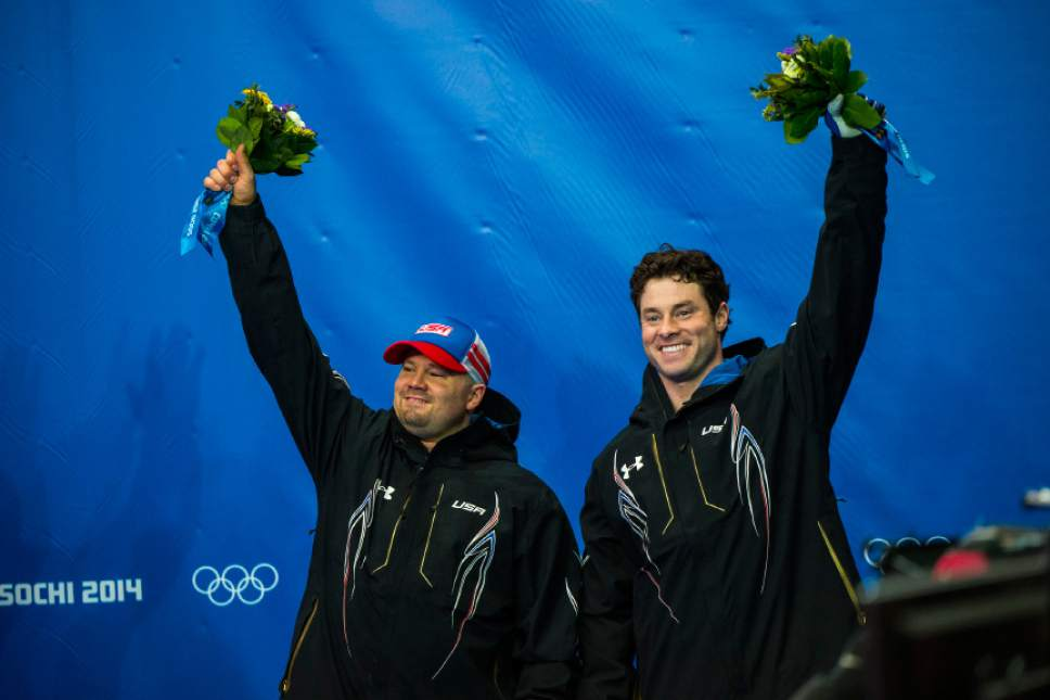 KRASNAYA POLYANA, RUSSIA  - JANUARY 17: Pilot Steven Holcomb, left, and brakeman Steven Langton, celebrate after competing in the men's two-man bobsled at Sanki Sliding Center during the 2014 Sochi Olympics Monday February 17, 2014. USA-1 with Steven Holcomb, of Park City, Utah, and Steve Langton, of Melrose, Mass., won the bronze medal with a time of 3:46.27. (Photo by Chris Detrick/The Salt Lake Tribune)