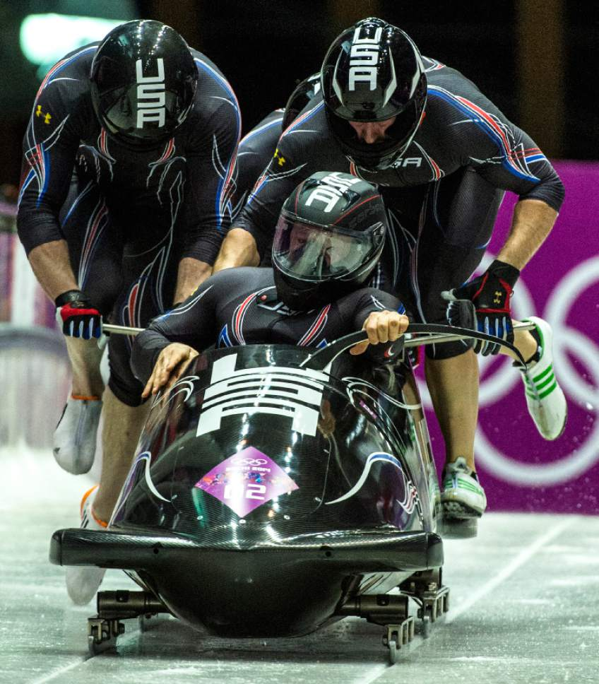 KRASNAYA POLYANA, RUSSIA  - JANUARY 22: Night Train 2, piloted by Steven Holcomb and pushed by Chris Fogt, Curtis Tomasevicz, Steve Langton, compete in the four-man bobsled at Sanki Sliding Center during the 2014 Sochi Olympics Saturday February 22, 2014. After the first run, they are in third place with a time of 54.89.  (Photo by Chris Detrick/The Salt Lake Tribune)