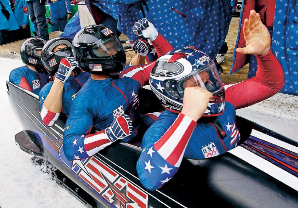 The United States' USA-1, with Steven Holcomb, front, Justin Olsen, Steve Mesler, and Curtis Tomasevicz, celebrate their gold medal finish during the men's four-man bobsled final competition at the Vancouver 2010 Olympics in Whistler, British Columbia, Saturday, Feb. 27, 2010.(AP Photo/Michael Sohn)