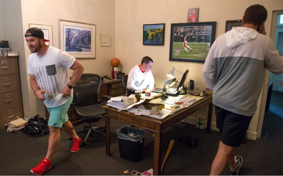 Leah Hogsten  |  The Salt Lake Tribune  Sports agent Greg Phillips, who represents his son, University of Utah kicker Andy Phillips, left, and University of Utah long snapper Chase Dominguez, right, works the phones as they negotiate NFL contracts, Saturday, April 29, 2017 as undrafted free agents. Phillips signed with the Chicago Bears and Dominguez signed with the New Orleans Saints.
