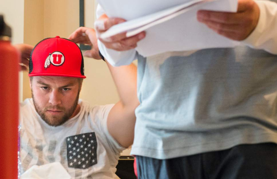 Leah Hogsten  |  The Salt Lake Tribune  University of Utah kicker Andy Phillips talks with his sports agent and father Greg Phillips talk about NFL draft prospects on Saturday. Phillips and University of Utah long snapper Chase Dominguez, negotiated NFL contracts,  April 29, 2017 for the two men as undrafted free agents. Phillips signed with the Chicago Bears and Dominguez signed with the New Orleans Saints.