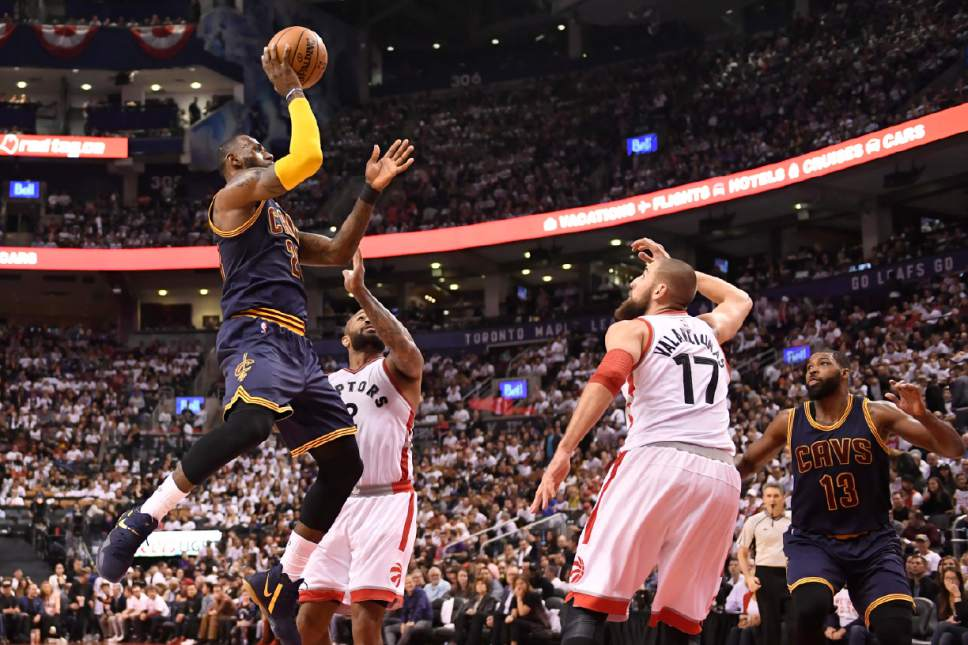 56027ce00e29 Cleveland Cavaliers forward LeBron James (23) takes a shot as Toronto  Raptors forward P.J.