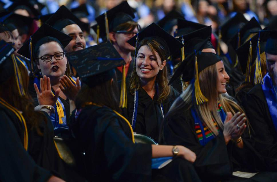Francisco Kjolseth   The Salt Lake Tribune Salt Lake Community College graduates take a moment to congratulate their neighbors as directed by a speaker during commencement ceremonies at the Maverik Center on Friday, May 5, 2017.
