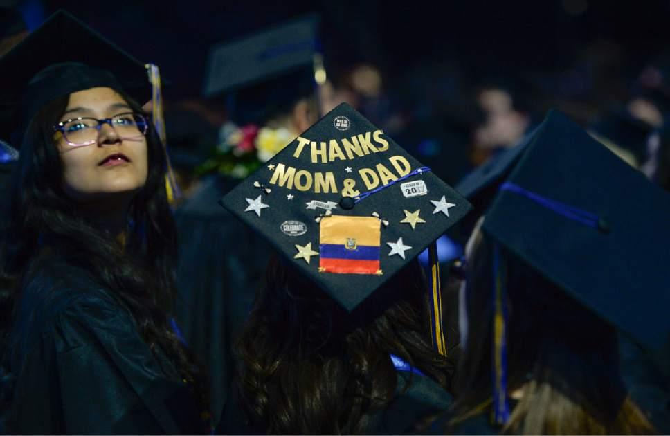 Francisco Kjolseth   The Salt Lake Tribune Expressing her thanks, a student joins fellow Salt Lake Community College graduates for commencement ceremonies at the Maverik Center on Friday, May 5, 2017.