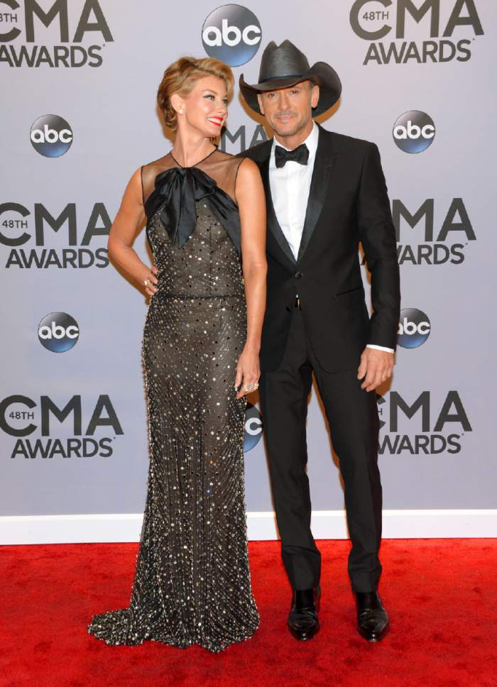 Faith Hill, left, and Tim McGraw arrive at the 48th annual CMA Awards at the Bridgestone Arena on Wednesday, Nov. 5, 2014, in Nashville, Tenn. (Photo by Evan Agostini/Invision/AP)